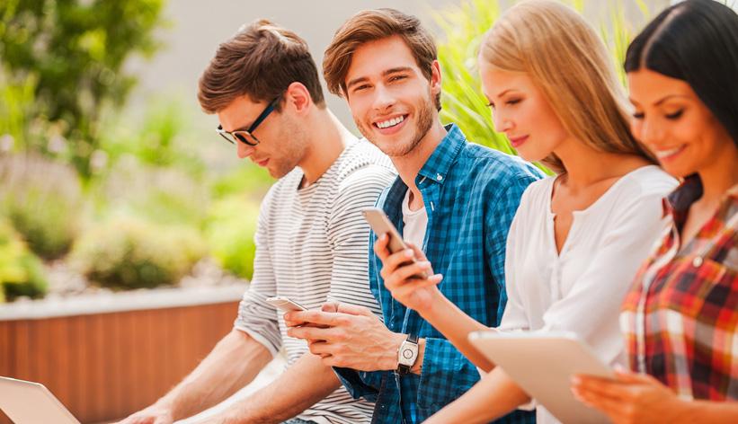 group of Australian Millennials using devices